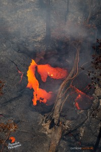 In this photo taken on Feb. 9, a fresh breakout near the stalled flow front pours lava into a depression. Photo credit: Extreme Exposure Media/Paradise Helicopters.