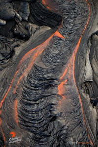 This photo, taken Feb. 23 at 6 p.m., shows the surface of a large river of lava cools into folds that resemble a wrinkled sheet. Photo credit: Extreme Exposure Media/Paradise Helicopters.