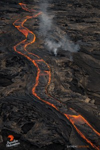 This photo, taken Feb. 23 at 6 p.m., shows a long river of lava snakes down the north flank of Pu'u 'O'o. Photo credit: Extreme Exposure Media/Paradise Helicopters.