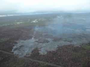 This photo, taken Feb. 24, shows a breakout along the north margin of the June 27 lava flow, looking down slope towards Highway 130. Civil Defense photo.