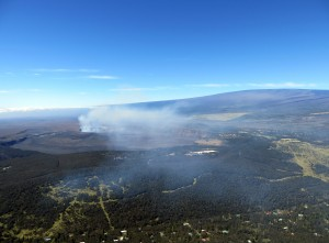The winds on Feb. 19 were carrying the gas plume from Halemaʻumaʻu towards the northeast. Volcano Village is in the bottom portion of the photograph and Mauna Loa is in the upper right. USGS HVO photo.