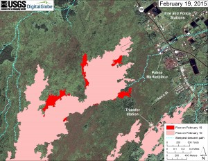 This large-scale map uses a satellite image acquired in March 2014 (provided by Digital Globe) as a base to show the area around the front of Kīlauea's active East Rift Zone lava flow. The area of the flow on February 10 is shown in pink, while widening and advancement of the flow as of February 19 is shown in red. The blue lines show steepest-descent paths calculated from a 1983 digital elevation model. USGS HVO map.
