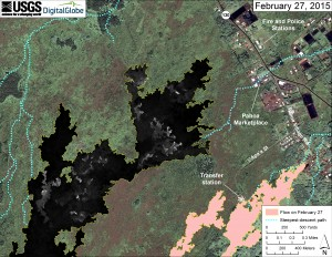 This map overlays a georegistered mosaic of thermal images collected during a helicopter overflight of the distal part of Kīlauea's active East Rift Zone lava flow on February 27 at about 11:40 AM. The base image is a satellite image acquired in March 2014 (provided by Digital Globe). The perimeter of the flow at that time is outlined in yellow. Temperature in the thermal image is displayed as gray-scale values, with the brightest pixels indicating the hottest areas (white areas are active breakouts). The blue lines show steepest-descent paths calculated from a 1983 digital elevation model. USGS HVO photo.