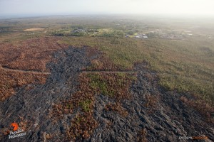 This photo taken on Feb. 6 shows virtually no activity is occurring in the vicinity of Pahoa, just a couple of smoldering spots about a mile upslope of the distal tip. Photo credit: Extreme Exposure/Paradise Helicopters.
