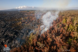 In this photo, taken Feb. 16, a few hot spots continue to expand the flow field just upslope of the Pahoa Marketplace. Photo credit: Extreme Exposure Media/Paradise Helicopters.