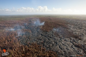 In this photo, taken Feb. 23 at 8 a.m., a large breakout, about a half mile downslope of the old geothermal pad, poured lava onto the middle of the flow field. Photo credit: Extreme Exposure Media/Paradise Helicopters.