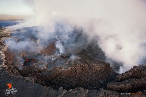 This photo, taken Feb. 26, shows a couple collapse pits that had been sloshing lava within Pu'u 'O'o crater. Photo credit: Extreme Exposure Media/Paradise Helicopters.