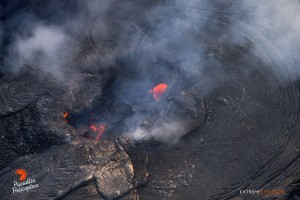 This photo, taken March 19, A couple of skylights in the solidified surface of a lava pond within Pu'u 'O'o crater. Photo credit: Extreme Exposure Media/Paradise Helicopters.