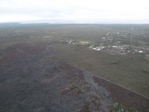 This photo, taken March 16, shows s view from the south flow margin, looking downslope towards Highway 130 and Pahoa Marketplace. Hawai'i County Civil Defense photo.