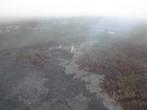 This photo, taken March 9, shows a view from the south flow margin, looking down slope towards Apaa Street. Hawai'i County Civil Defense photo.