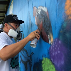 Oahu-based multimedia artist, East-3, placed the final touches on the latest installation of the Not Even Once Mural Project, an initiative focused on bringing large-scale anti-meth murals to schools across the state. Photo credit: Keep It Flowing LLC.