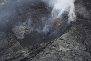 There are several incandescent and outgassing hornitos on the floor of Puʻu ʻŌʻō's crater, including the one shown in this photo, taken on March 24, which is at the northeast edge of the crater. Recent flows from the hornito appear black. USGS HVO photo.