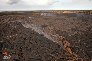 In this photo, taken March 17, a finger of lava pours from the tube approximately 4 to 5 miles downslope of Pu'u 'O'o. Photo credit: Extreme Exposure Media/Paradise Helicopters.