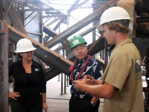 Pacific Biodiesel's Director of Operations Jenna Long and Agricultural Program Manager James Twigg-Smith explain to Governor Ige how the crushing mill, located on the lot adjacent to the refinery, fits into the Company's sustainability model. Pacific Biodiesel photo.