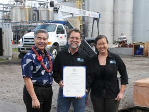 Governor David Ige presents Pacific Biodiesel President Robert King and Director of Operations Jenna Long with the proclamation naming March 18, 2015 Pacific Biodiesel Day. Pacific Biodiesel photo.