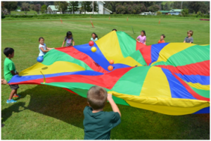 Parker students enjoy playing with a parachute at the school's Jump Rope for Heart event. Parker School photo.