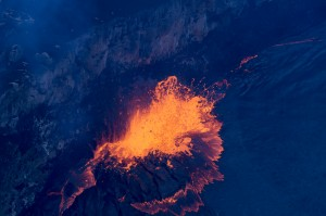 The lava level was high enough at the lava lake on the evening of April 23 that bits of spatter were reaching the rim of the Overlook crater. USGS/HVO photo.