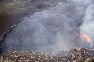 This photo shows the lava lake in the Overlook crater on the morning of April 26, when it reached to within 3 m (10 ft) of the floor of Halemaʻumaʻu. This is the highest the lava lake has reached during the current summit eruption. USGS/HVO photo.
