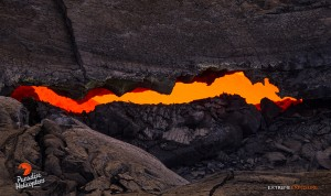 A long, thin skylight gives a peek at the raging river of lava feeding the flow, taken April 24. Photo credit: Extreme Exposure Media/Paradise Helicopters.