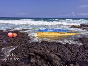 Overturned 20' skiff at Alan Davis shore, Oahu, reported April 22. Photo courtesy Nicole Woolsey and Ryan Tani.