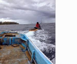 Boat retrieved from shoreline fronting the Aston Mahana Resort. Photo courtesy Kaanapali Beach Club.