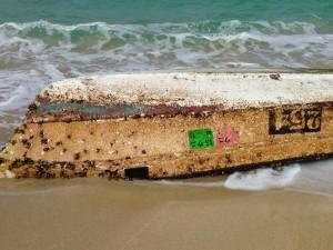 Overturned skiff reported Feb. 22 at beach near Kahuku Golf Course. Photo courtesy Lance Redding.