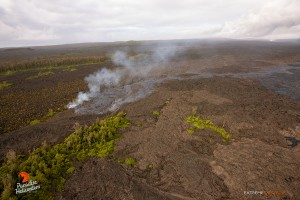 This photo, taken April 24, shows  a new branch of lava breaks off from the main flow to the east. Pu'u 'O'o sits in the upper right of the frame. Photo credit: Extreme Exposure Media/Paradise Helicopters.