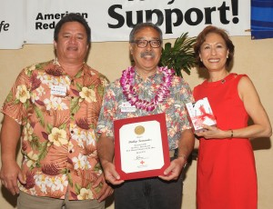 Photo of West Hawaii Volunteer of the Year Phillip Fernandez at Saturday's Red Cross Heroes recognition event with award presenters Mike Kaleikini of Puna Geothermal and Coralie Chun Matayoshi, CEO, Hawai'i Red Cross. Hawai'i Red Cross photo.