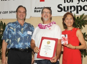 Photo of East Hawaii Volunteer of the Year Kenneth Cutting at Saturday's Red Cross Heroes recognition event with award presenters Frank Richardson of Kaiser Permanente and Coralie Chun Matayoshi, CEO, Hawai'i Red Cross. Hawai'i Red Cross photo.