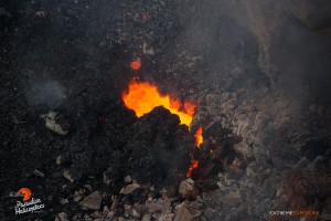 In this photo, taken on May 6, an opening along the eastern wall of Pu'u 'O'o, occasionally tossed lava into the air. Photo credit: Extreme Exposure Media/Paradise Helicopters.