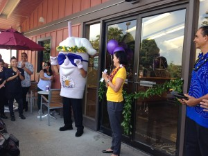 A company official and the Coffee Bean and Tea Leaf mascot at the grand opening of the Kea'au location of The Coffee Bean & Tea Leaf. Photo credit: Jamilia Epping.