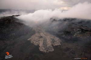 A breakout from an opening along the eastern wall (bright spot), spilled lava onto the crater's floor on the morning of May 6. Photo credit: Extreme Exposure Media/Paradise Helicopters.