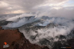 This photo, take May 6, shows The steamy floor of Pu'u 'O'o . Molten lava was visible in several collapse pits and skylights in the crater's floor. Photo credit: Extreme Exposure Media/Paradise Helicopters.