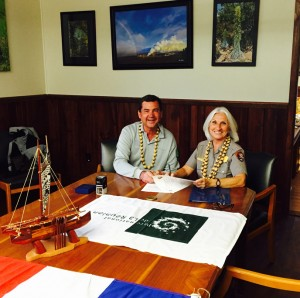 NPS Photo of Hawai'i Volcanoes National Park Superintendent Cindy Orlando (right) and Daniel Gonthier, President of La Reunion National Park, signing the sister park agreement at the Kīlauea Visitor Center headquarters, May 20, 2015.