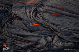 June 11: Folds of pahoehoe curl over and crack, revealing the orange glow of the molten lava within. Photo: Extreme Exposure Media/Paradise Helicopters.