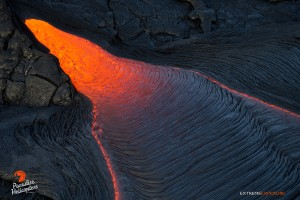 June 11: Lava pours out of a break in the wall of a lava tube. Photo: Extreme Exposure Media/Paradise Helicopters.