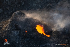 June 11: One of the spatter cones within Pu'u 'O'o crater spitting bits of lava. Photo: Extreme Exposures Media/Paradise Helicopters.