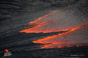 June 11: The trailing edge of a fresh breakout cools, forming finger-like protrusions, floating on the river of molten lava. Photo: Extreme Exposure Media/Paradise Helicopters.