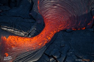 June 25:  A breakout from the top of a tube sends lava over both sides of its raised roof.  Photo: Extreme Exposure Media/Paradise Helicopters.