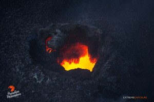 2015 06 25 - Puna, Hawaii:  A skylight offers a peek into the fiery depths beneath Pu'u 'O'o crater's floor.   Photo: Extreme Exposure Media/Paradise Helicopters
