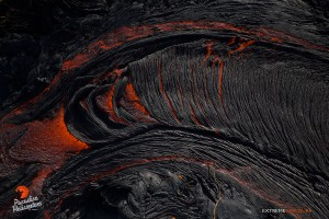 June 4: The crusted surface of a river of lava breaks apart as it picks up a little speed and flows down a slope. Photo: Extreme Exposure Media/Paradise Helicopters.