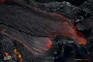 June 4: Lava pours out of a tube and feeds the river. Photo: Extreme Exposure Media/Paradise Helicopters.