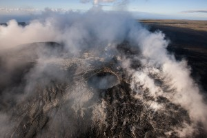June 4: A little pond of lava was still visible within the collapse pit inside of Pu'u 'O'o crater, while a couple of skylights were also glowing. Photo: Extreme Exposure Media/Paradise Helicopters.