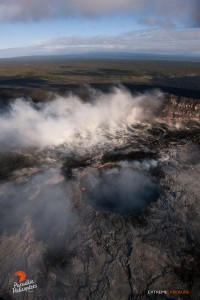 June 25:  The collapse pit within Pu'u 'O'o crater still contains a sloshing lava pond, but rising gas plumes obscured most of it while we were over it.    Photo: Extreme Exposure Media/Paradise Helicopters.