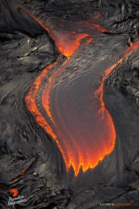 July 9: The surface of this pahoehoe breakout is cooling from the moment it exits the tube, creating wrinkles in its shiny surface.  Photo: Extreme Exposure Media/Paradise Helicopters.