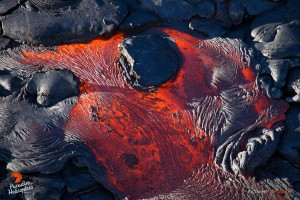 July 16: A luminescent breakout of pahoehoe near the perched channel.  Photo: Extreme Exposure Media/Paradise Helicopters.