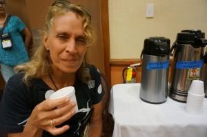 Hamakua farmer Shannon DeMaster tasting coffee berry borer defects in the defect/ coffee quality workshop. Hawai'i Coffee Association photo.