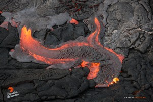 July 23:   A little river of lava fills a low spot on the flow field.  Photo: Extreme Exposure Media/Paradise Helicopters.