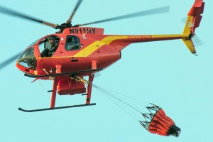 Photo of helicopter crew assisting in Kawaihae brush fire effort taken Saturday. Photo credit: M. Scott Smith.