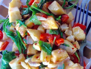 """Breadfruit """"Ulu"""" Home Fries with onions, peppers and arugula. Photo credit: Kristin Frost Albrecht."""